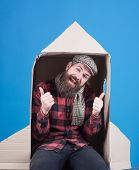 Happy Bearded Man Sit In Cardboard Rocket. Adventure Concept. Smiling Man Flying To Space In Rocket. poster