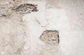 Asphalt Damage. Damaged Asphalt Road Pothole With Deep Holes Selective Focus poster