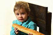 Fresh Bread. Little Child Hold Fresh French Baguette. Fresh Food Is The Best. Fresh Bakery Products. poster