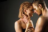 Sexy Couple With Golden Body Art Makeup, Copy Space. Erotic Games Of Couple In Love. Golden Collagen poster