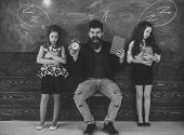 Evil Teacher. Teacher And Girls Pupils In Classroom, Chalkboard On Background. Children And Teacher  poster