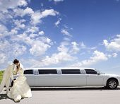 picture of limousine  - Happy bride and groom about limousine in wedding day - JPG