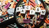 pic of racial discrimination  - Racism concept with people of different ethnicities under magnifying glass - JPG