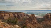 stock photo of gneiss  - Colorado National Monument is a part of the National Park Service near the city of Grand Junction Colorado. Spectacular canyons cut deep into sandstone and even granite�gneiss�schist rock formations in some areas.