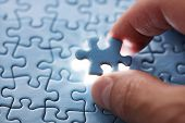 pic of puzzle  - The last piece of jigsaw puzzle concept for solutions and completion - JPG