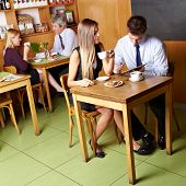 Different business people sitting in a caf�?�©