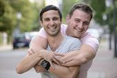 foto of homosexual  - Portrait of a happy gay couple outdoors - JPG