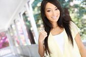 image of asian woman  - A pretty asian woman at home on the porch - JPG