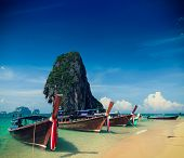 Holiday vacation concept background - Long tail boat on tropical beach with limestone rock, Krabi, T