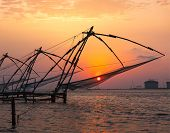 picture of fishnet  - Kochi chinese fishnets on sunset - JPG