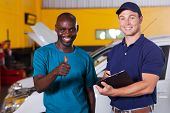 happy african customer giving thumb up in car repair shop
