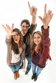 Three young people raising their hands