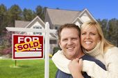 foto of yard sale  - Happy Couple Hugging in Front of Sold Real Estate Sign and House - JPG