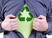 A man wearing shirt transforming into Eco superhero with green recycle arrow symbol underneath on ch