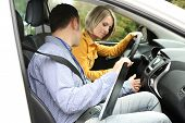 foto of driving school  - Learner driver student driving car with instructor - JPG