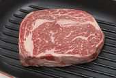 stock photo of ribeye steak  - A gourmet Australian wagyu ribeye steak in a grill - JPG
