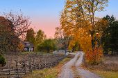 stock photo of dirt road  - Landscape in the province of Smaland in southern Sweden in autumn - JPG