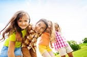 foto of 6 year old  - Group of little 6 and 7 years old smiling kids smiling standing outside in the park