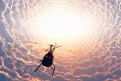 stock photo of rescue helicopter  - Civilian helicopter of mystical clouds - JPG