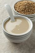 stock photo of sesame seed  -  Bowls with tahini paste and roasted sesame seeds  - JPG