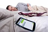 stock photo of goodnight  - cell phone screen showing text messages while male is in bed - JPG