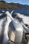 foto of outboard engine  - Trace motor boats on the water of a mountain lake - JPG