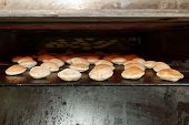 image of pita  - Old baking oven with baked pita bread - JPG