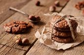 image of cookie  - chocolate chip cookies with walnuts on a wood background. toning. focus on the second cookies from below