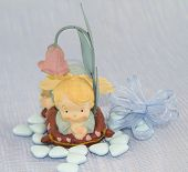 stock photo of baptism  - Photo for newborn boy o baptism with candy - JPG