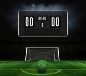 picture of football pitch  - Football in brazilian colours and scoreboard against football pitch and goal under spotlights - JPG