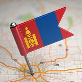 stock photo of bator  - Small Flag of Mongolia on a Map Background with Selective Focus - JPG