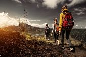 stock photo of cross hill  - Group of hikers walking on the caldera of volcano of Batur - JPG