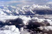 picture of puffy  - Blue sky and puffy clouds on height of 5000 m above Earth - JPG