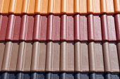 pic of red roof tile  - Colorful roof tiles in sunny day closeup - JPG
