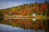 stock photo of trailer park  - Fall forest with colorful autumn leaves and highway 60 reflecting in Lake of Two Rivers - JPG