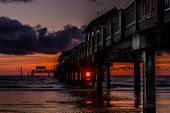 foto of florida-orange  - Sunset shining through pier 60 on Clearwater Beach - JPG