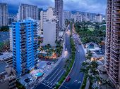 picture of waikiki  - Waikiki skyline in the evening with clouds rolling in over the mountains - JPG