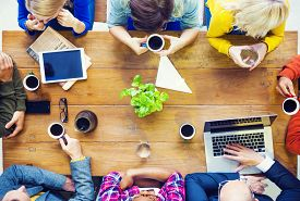 image of cafe  - Multiethnic People with Startup Business Talking in a Cafe - JPG