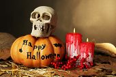 stock photo of bloody  - Halloween pumpkin  and bloody candles on wooden table on dark color background - JPG