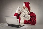 pic of letters to santa claus  - Santa typing on pc  - JPG