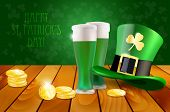 picture of golden coin  - Wooden table with green hat green beer and golden coins  - JPG