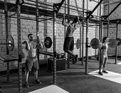 foto of gym workout  - Barbell weight lifting group weightlifting workout exercise gym - JPG