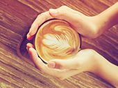 stock photo of latte  - cup of coffee latte art in the coffee shop vintage color - JPG