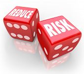 foto of dice  - Reduce Risk words on two red dice to illustrate lowering your chances for liability - JPG