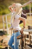 stock photo of country girl  - Young woman portrait of a cowboy in the open air - JPG