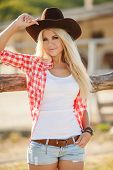 pic of cowboy  - Young woman portrait of a cowboy in the open air - JPG