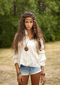 picture of hippy  - Beautiful hippie girl with rope in hair and medallion - JPG