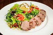 picture of veal meat  - Veal meat with fresh vegetable salad - JPG