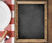 stock photo of chalkboard  - Menu chalkboard top view on table with plate - JPG