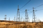 stock photo of electricity pylon  - High voltage power lines with electricity pylons - JPG